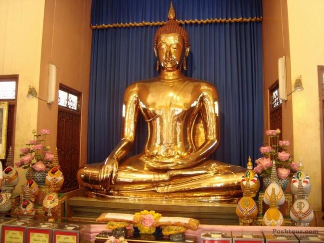 Скульптура Будды из золота